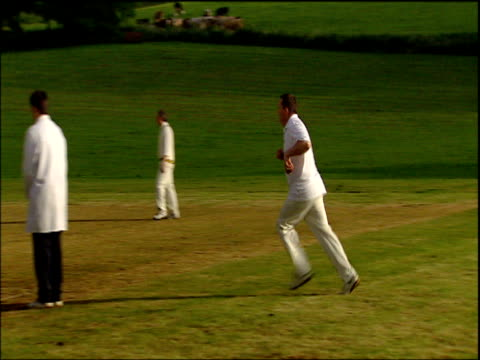 Villagers playing cricket in Little Bredy Dorset