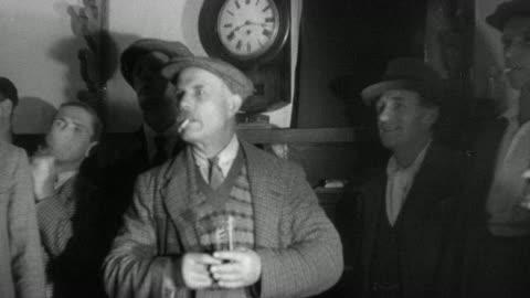 1937 montage villagers playing darts / essex, england - 1937 bildbanksvideor och videomaterial från bakom kulisserna