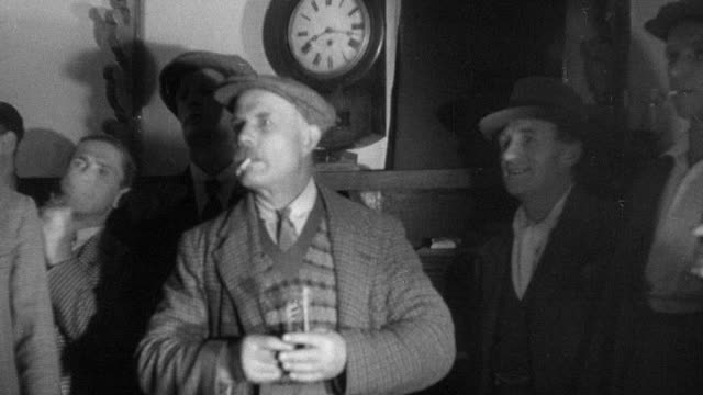 1937 montage villagers playing darts / essex, england - 1937 stock-videos und b-roll-filmmaterial