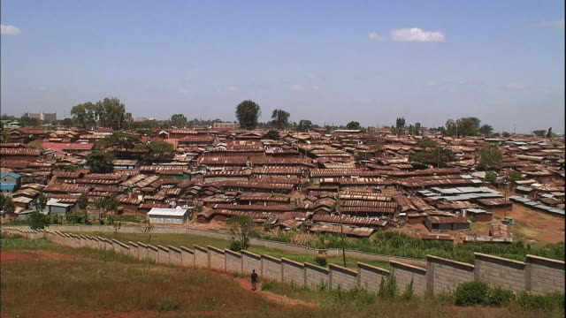 Villagers walk home to Kibera.