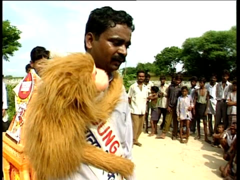 Villagers watch puppet show advocating smaller families Uttar Pradesh India; Sep 1998