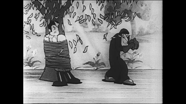 vidéos et rushes de villain captures betty boops boyfriend and ties him to tree trunk - expression positive