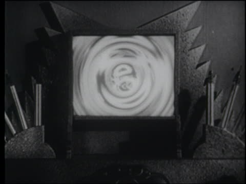b/w 1940 villain, emperor ming, appears on futuristic video screen - 1940 stock videos and b-roll footage
