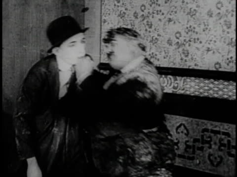 1920 montage villains taking turns punching hero in head - larry semon stock videos and b-roll footage