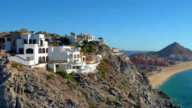 villas on top of cliff above beach - viewpoint stock videos & royalty-free footage