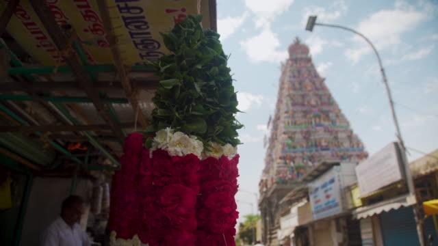 vimana of kapaleeswarar hindu temple and floral garland market at chennai - chennai stock videos & royalty-free footage