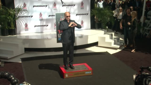 clean vin diesel immortalized with hand and footprint ceremony at tcl chinese theatre imax on april 01 2015 in hollywood california - ludacris stock videos & royalty-free footage