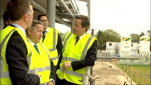vince cable criticises david cameron speech on immigration; surrey: woking: hoe valley project: various shots of david cameron visiting building site... - vince cable stock videos & royalty-free footage