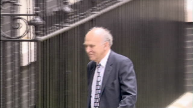 vince cable mp along and into number 10 - vince cable stock videos & royalty-free footage