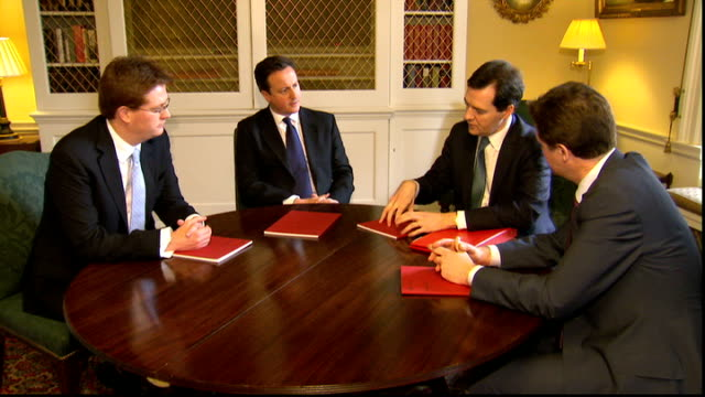 vince cable unveils budget negotiations london downing street int gvs david cameron mp george osborne nick clegg mp and danny alexander mp sitting... - ニック クレッグ点の映像素材/bロール