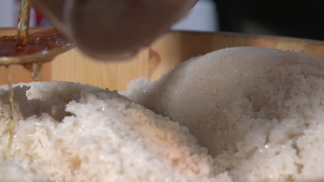 vinegar being poured onto cooked rice - vinegar stock videos & royalty-free footage