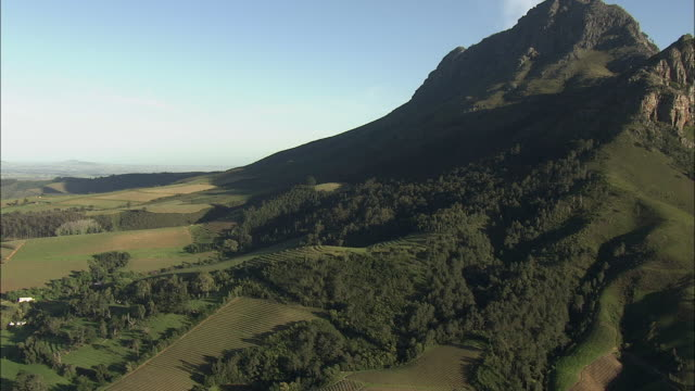 aerial vineyard at foot of banhoek mountains, stellenbosch, western cape, south africa - stellenbosch stock videos and b-roll footage