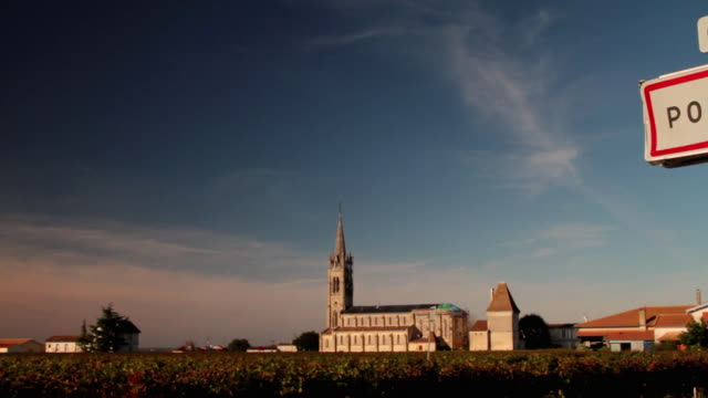 WS PAN Vineyards and church with town sign for Pomerol in foreground / Aquitaine, France