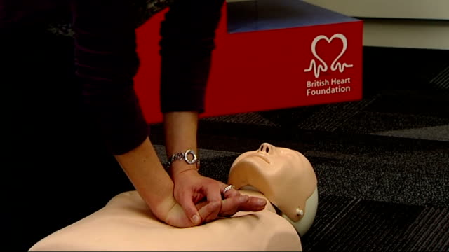 vinnie jones fronts cpr campaign video for british heart foundation tanith galer interview sot general views of ellen mason giving chest compressions... - vinnie jones stock videos & royalty-free footage