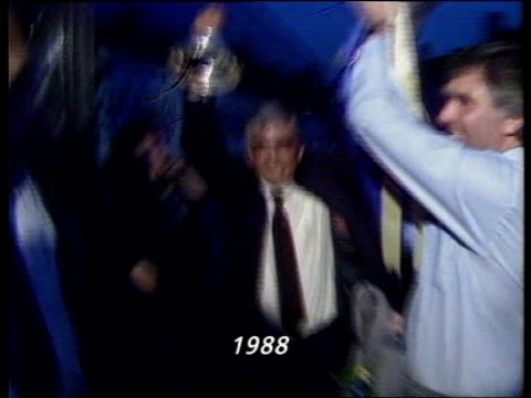 controversial video 'soccers hard men' ext wembley ms bobby gould as holds up fa cup along to c'manseq jones shakes crowd after cup final nat - fa cup stock-videos und b-roll-filmmaterial