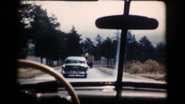 vintage 16mm driving car 1956 (hd1080) - 1950 stock videos & royalty-free footage