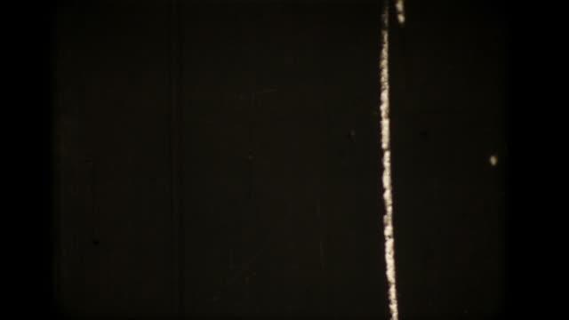 vintage 16mm scratched film leader (hd1080) - film leader stock videos & royalty-free footage
