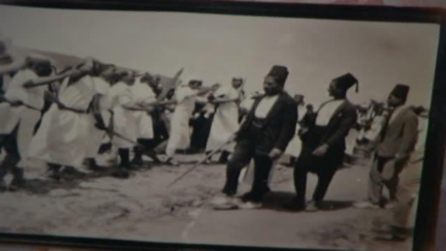 vídeos y material grabado en eventos de stock de vintage 1950s era black and white photograph of ashura commemorations in nabatieh. men in traditional lebanese costumes standing in front of row of... - ashura