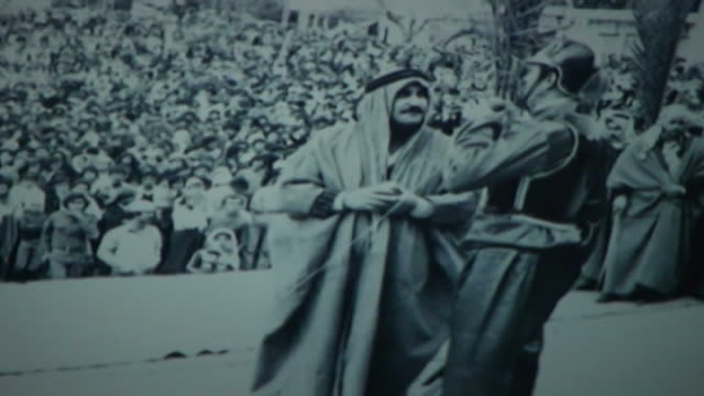 vintage 1950s era black and white photograph of ashura commemorations in nabatieh.two men standing on a stage; one in traditional dress wearing an... - toned image stock videos & royalty-free footage