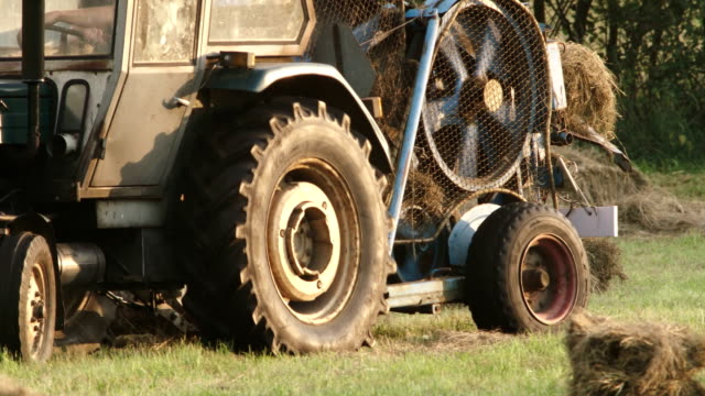 vintage agriculture equipment - hay baler stock videos & royalty-free footage