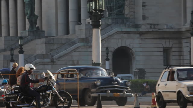 MS of vintage American cars driving / Havana / Capitol building / capital