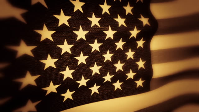 a vintage american flag waves in the breeze. - getönt stock-videos und b-roll-filmmaterial