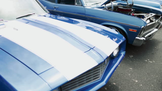 vintage and tuned car exposition in monterey california monterey car week - gender stereotypes stock videos and b-roll footage