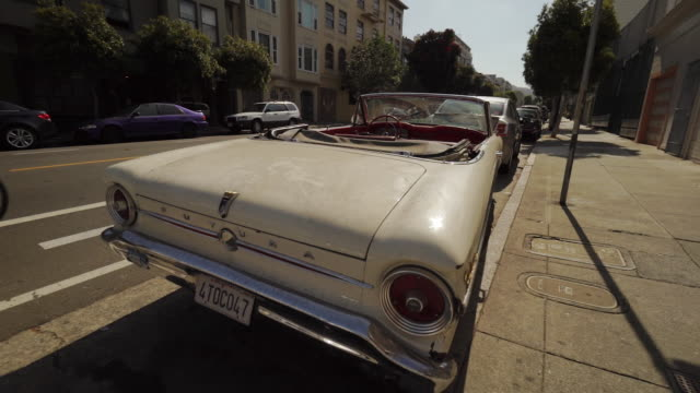 vintage automobile in mission district of san francisco, usa - driving plate stock videos & royalty-free footage