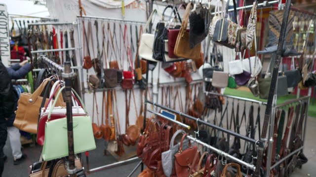 vintage bags for sale on a market stall in portobello road - flea market stock videos & royalty-free footage