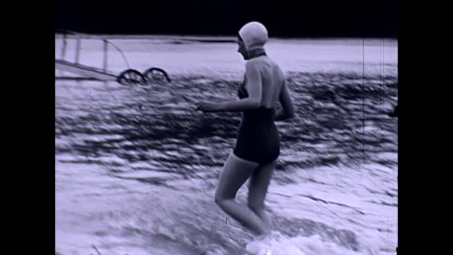 vintage bather enters the english channel - swimming costume stock videos & royalty-free footage