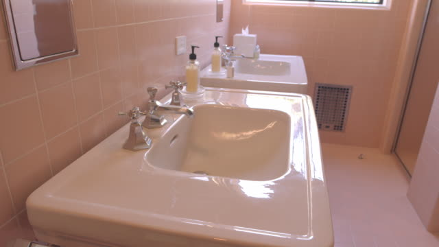 ts vintage bathroom in frank sinatra's 1947 house in palm springs - ava gardner stock videos & royalty-free footage