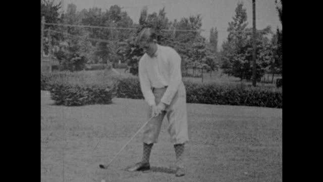 vintage black and white footage of bobby jones the american amateur golfer demonstrating his shots circa 1920s. - golf bildbanksvideor och videomaterial från bakom kulisserna