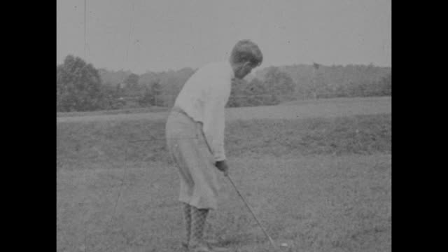 vintage black and white footage of bobby jones the american amateur golfer demonstrating his shots circa 1920s. - amateur stock videos & royalty-free footage