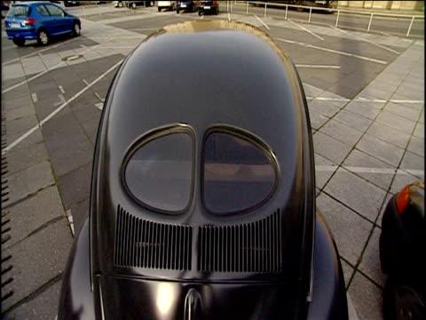 vintage black volkswagen beetle berlin - beetle stock videos & royalty-free footage