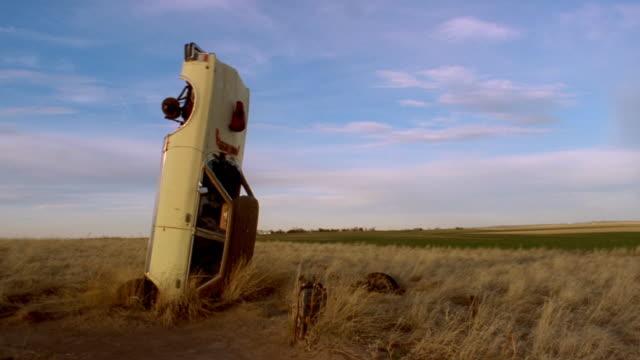 Vintage car at Carhenge (replica of Stonehenge) in High Plains of Nebraska