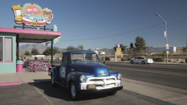 vintage car at mr d route 66 diner at kingman, route 66, arizona, united states of america, north america - kingman arizona stock videos & royalty-free footage