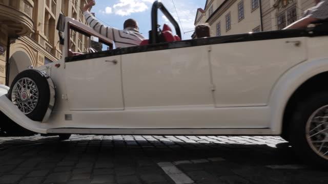 vidéos et rushes de vintage car & tram in castle district, prague, czech republic, europe - ligne de tramway