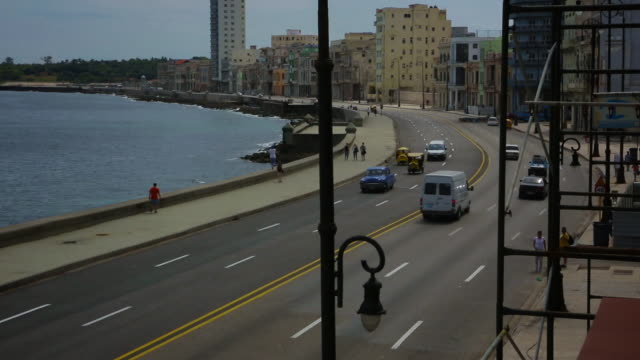 vintage cars driving on malecon day - hotel nacional stock videos and b-roll footage