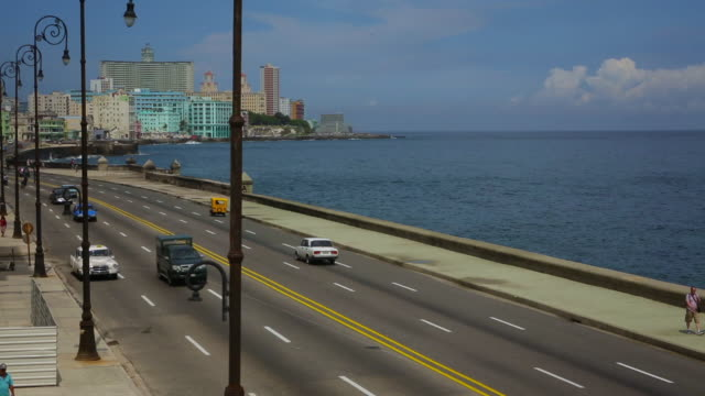 vintage cars driving on malecon with ocean in background - hotel nacional stock videos and b-roll footage