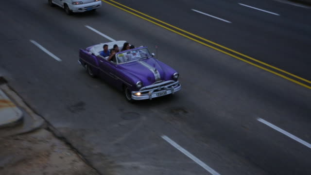 vintage cars on malecon in cuba - hotel nacional stock videos and b-roll footage