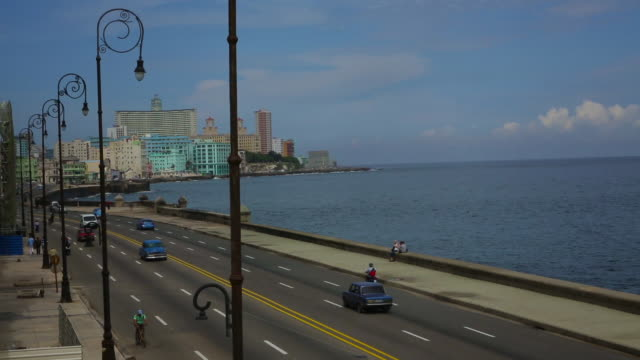 vintage cars on malecon in day w/ hotel nacional in background - hotel nacional stock videos and b-roll footage