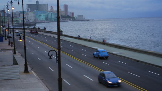 vintage cars on malecon w/hotel nacional in background - hotel nacional stock videos and b-roll footage