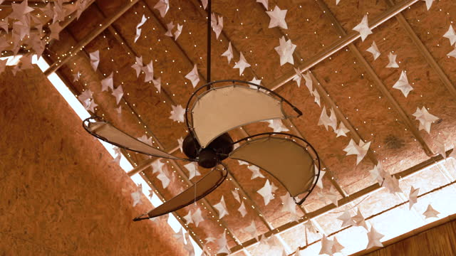 vintage ceiling fan and paper stars hanging on ceiling - ceiling stock videos & royalty-free footage
