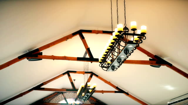 vintage chandelier on ceiling. - lampada elettrica video stock e b–roll