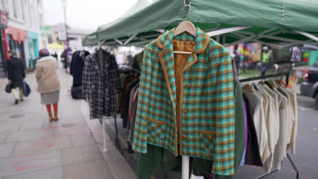 a vintage coat for sale on a market stall in portobello road, london - notting hill videos stock videos & royalty-free footage