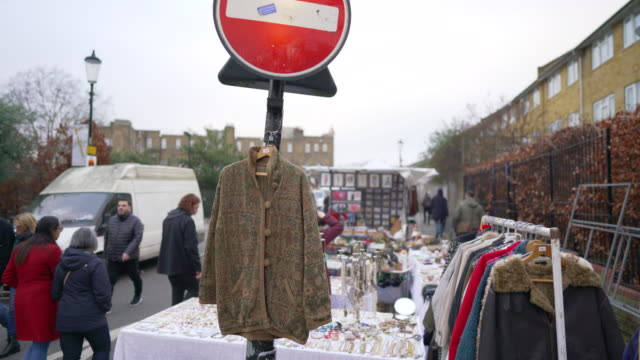 a vintage coat hanging on a lamp post in portobello road - second hand stock videos & royalty-free footage