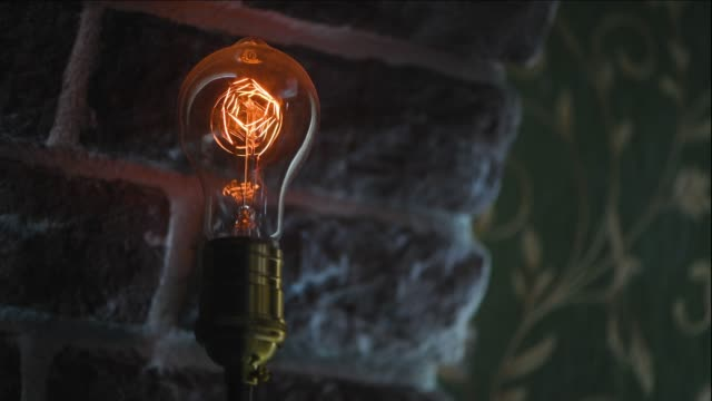 vintage filament bulb flickering - incandescent bulb stock videos and b-roll footage