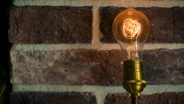 vintage filament bulb flickering - brick stock videos & royalty-free footage