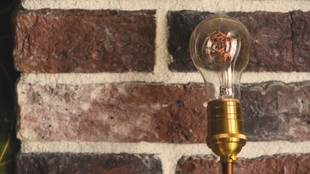 vintage filament  bulb lighting up - incandescent bulb stock videos and b-roll footage