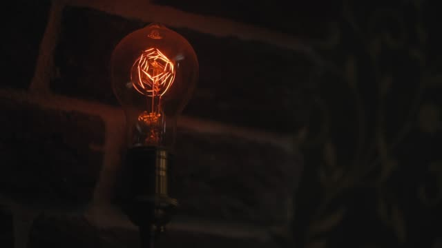 vintage filament bulb lighting up - brick stock videos & royalty-free footage
